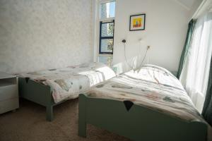 Bedroom with double bed and balcony