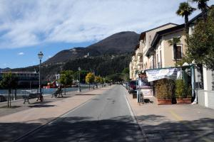 Lake Garda and promenade in front of apartments