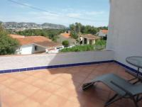 Quiet terraced house with 2 bedrooms and sea view, large secluded garden, terraces